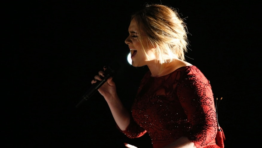 "February 15, 2016. Singer Adele performs ""All I Ask"" on stage at the 58th Grammy Awards in Los Angeles, California."