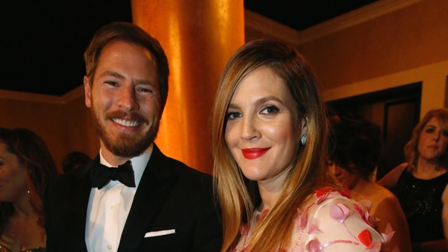 Drew Barrymore and husband Will Kopelman in happier times in 2014.