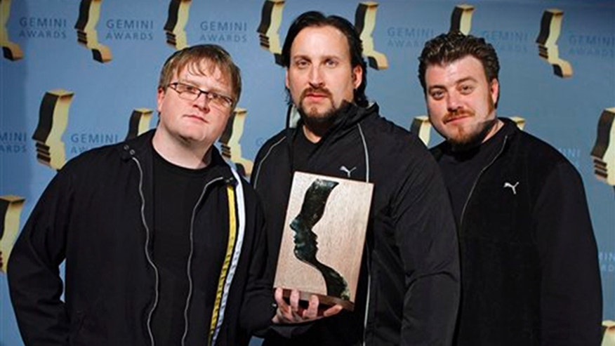 'Trailer Park Boys' cast members, left to right, Michael Smith, John Paul Tremblay, and Robb Wells, hold their achievement award at the 24th Annual Gemini Awards in Calgary. Smith was arrested in Los Angeles on suspicion of misdemeanor battery. (Larry Macdougal /The Canadian Press via AP)
