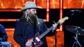 FILE - In this Dec. 2, 2015, file photo, Chris Stapleton performs at the 2015 Artists of the Year Show at Schermerhorn Symphony Center in Nashville, Tenn. Chris Stapleton dominated at the Grammys and the Country Music Association Awards, but will he repeat at the Academy of Country Music Awards on Sunday, April 3, 2016? Stapleton is the leading nominee with seven, but he's not up for the top award: entertainer of the year. Instead, he will compete for album, song and male vocalist of the year. He won new male vocalist of the year in an early announcement.(Photo by Donn Jones/Invision/AP, File)