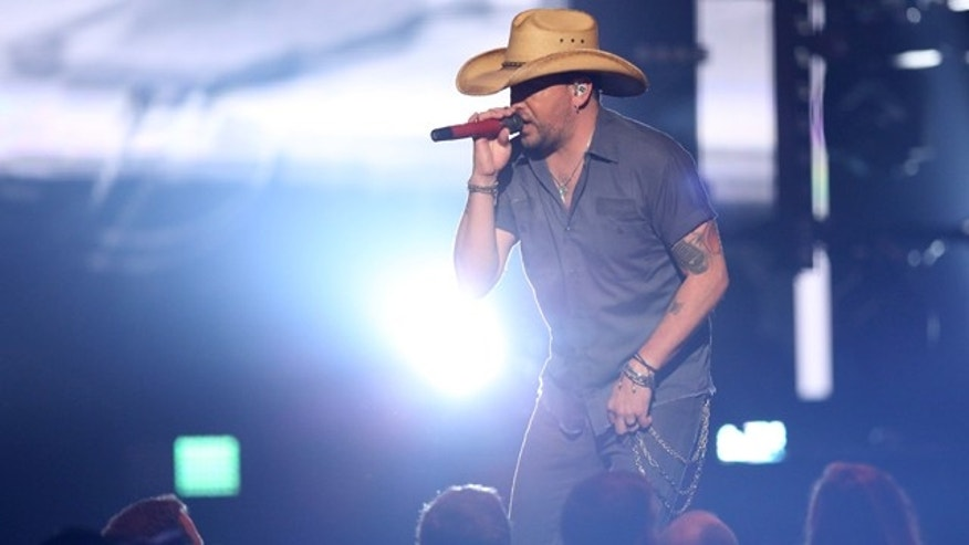 April 3, 2016: Jason Aldean performs Lights Come On at the 51st annual Academy of Country Music Awards at the MGM Grand Garden Arena in Las Vegas. (Photo by Matt Sayles/Invision/AP)