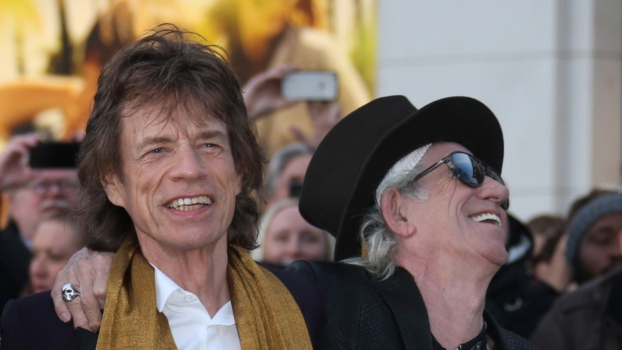 Members of the band The Rolling Stones, Mick Jagger, left, and Keith Richards pose for photographers upon arrival at the Rolling Stones Exhibitionism preview in London, Monday, April 4, 2016. (Photo by Joel Ryan/Invision/AP)