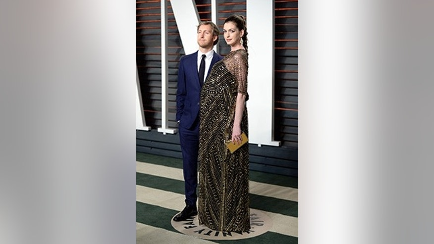 FILE- In this Feb. 28, 2016, file photo, Adam Shulman, left, and Anne Hathaway arrive at the Vanity Fair Oscar Party in Beverly Hills, Calif. (Photo by Evan Agostini/Invision/AP, File)