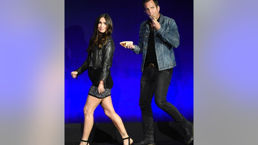 "Megan Fox, left, and Will Arnett, cast members in the upcoming film ""Teenage Mutant Ninja Turtles: Out of the Shadows,"" take the stage during the Paramount Pictures presentation at CinemaCon 2016, the official convention of the National Association of Theatre Owners (NATO), at Caesars Palace on Monday, April 11, 2016, in Las Vegas, NV."