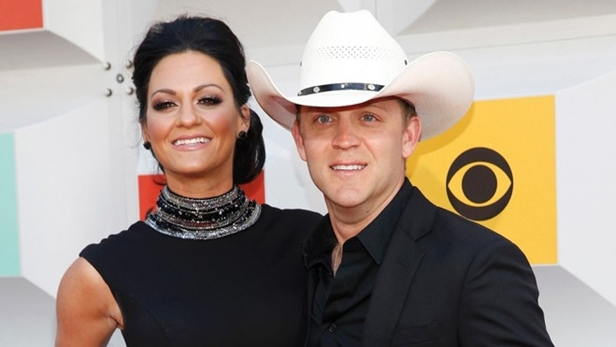 April 3, 2016. Singer Justin Moore and his wife, Kate, arrive at the 51st Academy of Country Music Awards in Las Vegas.