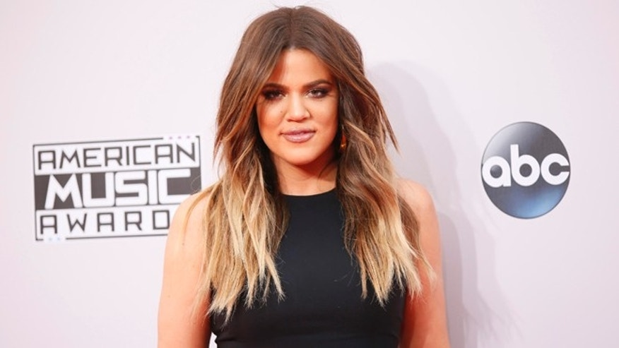November 23, 2014. Khloe Kardashian arrives at the 42nd American Music Awards in Los Angeles.