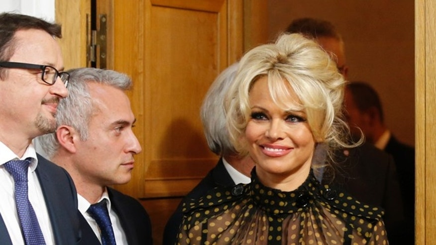January 19, 2016. Pamela Anderson arrives at a news conference to protest the force-feeding of geese used in the production of foie gras, in Paris, France.