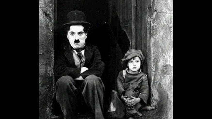 "Charlie Chaplin and Jackie Coogan in ""The Kid."""