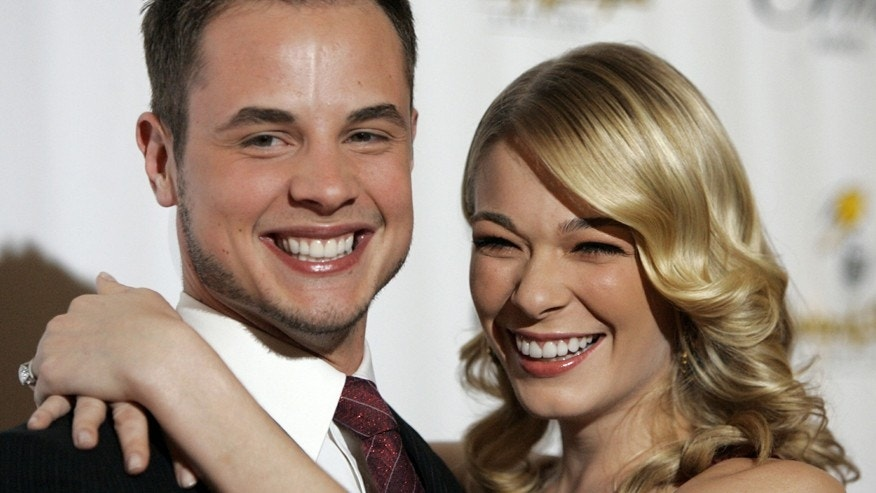 Music recording artist LeAnn Rimes and her then-husband Dean Sheremet smile at the 14th annual Ella awards at the Beverly Hilton hotel in Beverly Hills on October 10, 2005.