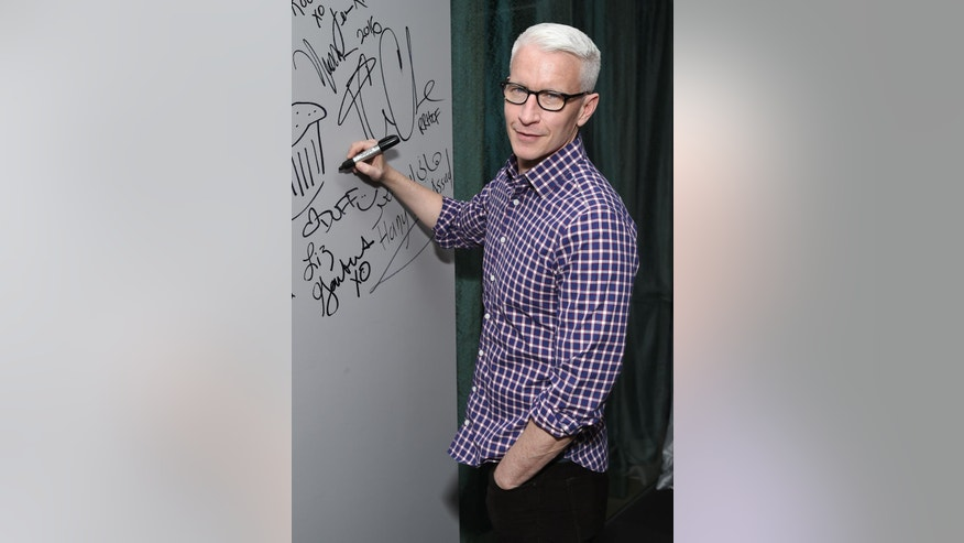 "FILE - In this April 15, 2016 file photo, CNN News anchor Anderson Cooper appears at AOL's BUILD Speaker Series to discuss the HBO documentary, ""Nothing Left Unsaid"", at AOL Studios in New York. Cooper's name has been circulating as a possible replacement for Michael Strahan on the morning talk show, ""Live! With Kelly and Michael."" Strahan, who started in 2012, is leaving to work full-time at ""Good Morning America"" and ABC announced that his last day will be on May 13. (Photo by Evan Agostini/Invision/AP, File)"
