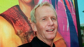 """An April 18, 2001 photo of Australian actor Paul Hogan at a screening for """"Crocodile Dundee in Los Angeles."""" Hogan has been cleared to return home to the United States after he was barred last month from leaving Australia because of a disputed tax bill. (AP)"""