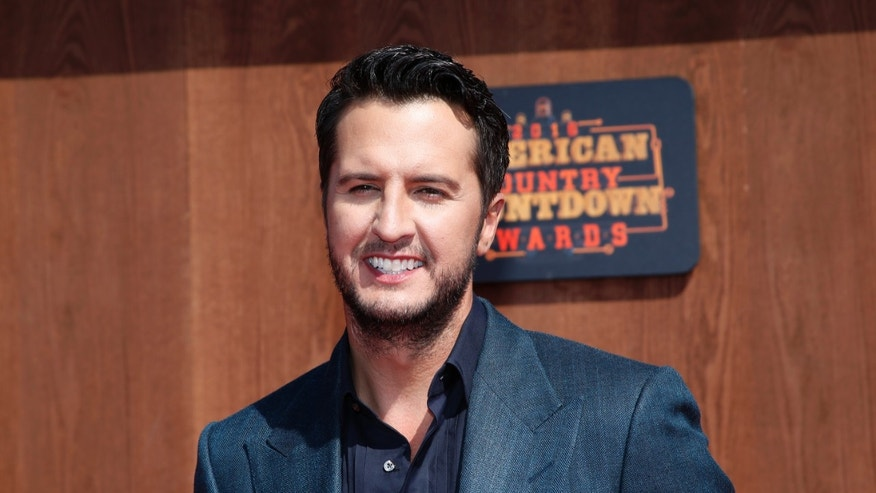 Luke Bryan arrives at the American Country Countdown Awards at the Forum on Sunday, May 1, 2016 in Inglewood, Calif. (Photo by Danny Moloshok/Invision/AP)
