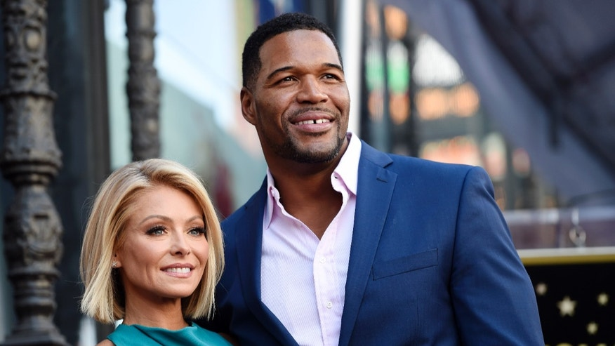 Kelly Ripa and Michael Strahan pose during a ceremony honoring Ripa with a star on the Hollywood Walk of Fame in 2015.