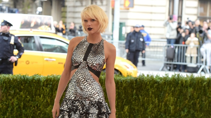 "FILE - In this Monday, May 2, 2016 file photo, Taylor Swift arrives at The Metropolitan Museum of Art Costume Institute Benefit Gala, celebrating the opening of ""Manus x Machina: Fashion in an Age of Technology"" in New York."
