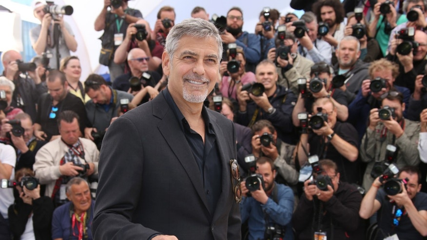 Actor George Clooney poses for photographers during a photo call for the film Money Monster at the 69th international film festival, Cannes, southern France, Thursday, May 12, 2016. (AP Photo/Thibault Camus)
