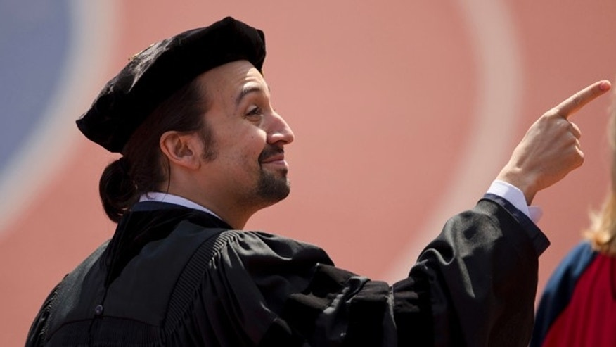 "Lin-Manuel Miranda, creator of the Broadway musical ""Hamilton,"" pointsn during the University of Pennsylvania commencement ceremony, Monday, May 16, 2016, in Philadelphia. Miranda will speak at the ceremony and receive an honorary degree.   (AP Photo/Matt Rourke)"