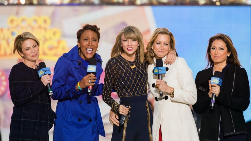 Oct. 30, 2014: 'Good Morning America' meteorologist Ginger Zee, far right, poses with her colleagues and singer Taylor Swift.