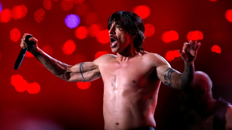 Anthony Kiedis of The Red Hot Chili Peppers performing during the Super Bowl halftime show