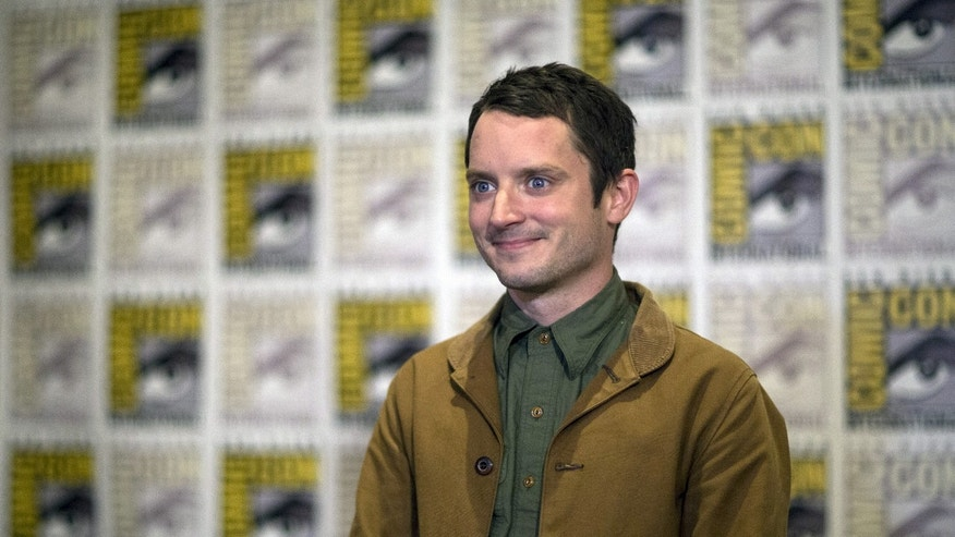 "Actor Elijah Wood poses at a press line for ""The Hunger Games: Mockingjay - Part 2"" during the 2015 Comic-Con International Convention in San Diego, California July 9, 2015. REUTERS/Mario Anzuoni - RTX1JSRV"