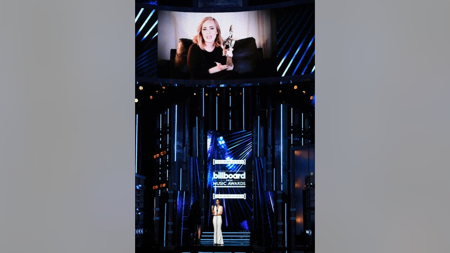 Kate Beckinsale presents the award for top Billboard 200 album to Adele, pictured onscreen, via satellite at the Billboard Music Awards at the T-Mobile Arena on Sunday, May 22, 2016, in Las Vegas. (Photo by Chris Pizzello/Invision/AP)