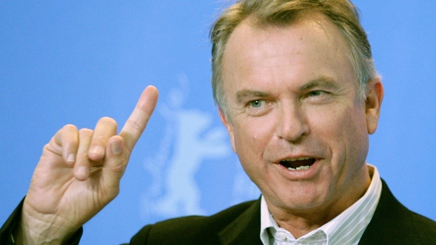 Actor Sam Neill poses during a photocall to present his film 'Angel' running in competition at the 57th Berlinale International Film Festival in Berlin February 17, 2007. The festival runs from February 8-18.     REUTERS/Hannibal Hanschke (GERMANY) - RTR1MI9G
