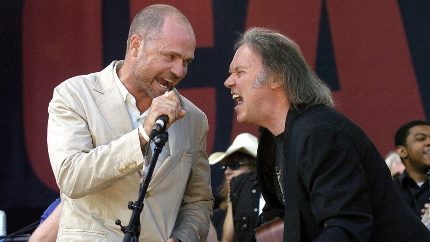 In this July 2, 2005, file photo, Gord Downie of The Tragically Hip (left) and Neil Young perform during the finale of the Canadian Live 8 concert in Barrie, Ont.
