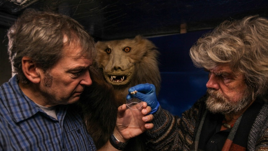 Mark Evans and Reinhold Messner taking a sample from a claimed 'yeti' specimen.