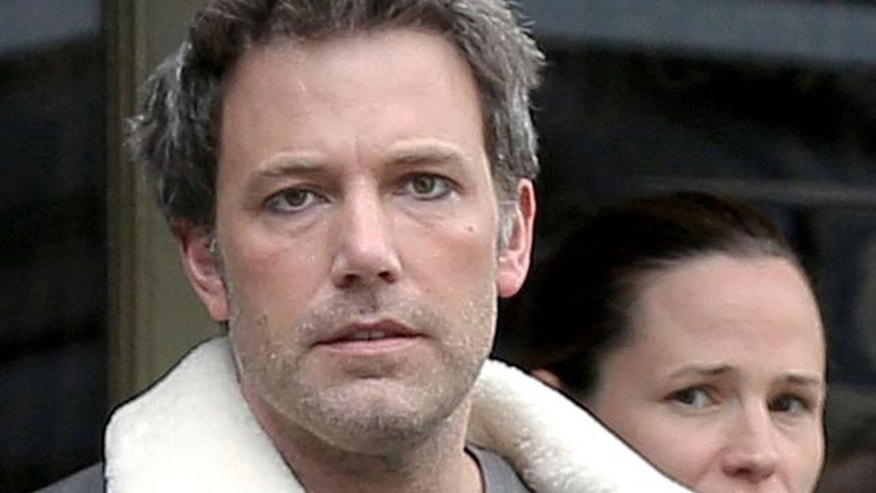 Ben Affleck wears eyeliner during a family outing in London.