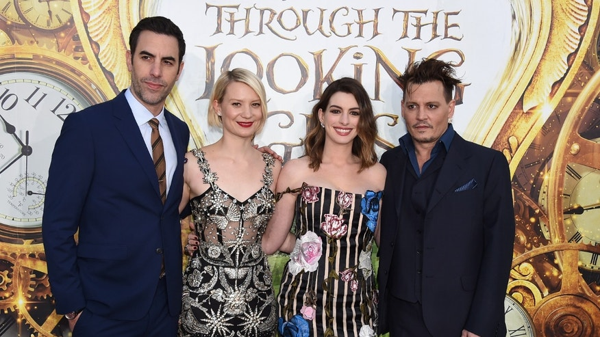 "Sacha Baron Cohen, Mia Wasikowska, Anne Hathaway and Johnny Depp at the Los Angeles premiere of ""Alice Through the Looking Glass."""