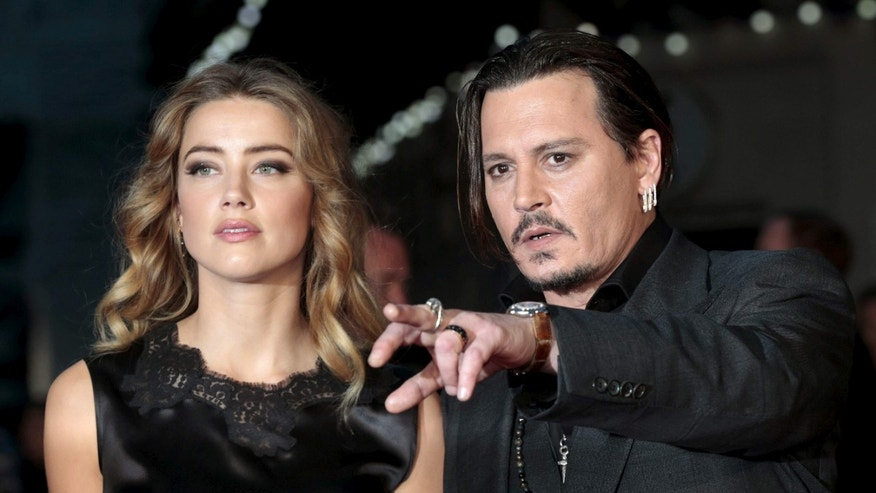 "Johnny Depp and wife Amber Heard at premiere of ""Black Mass."""
