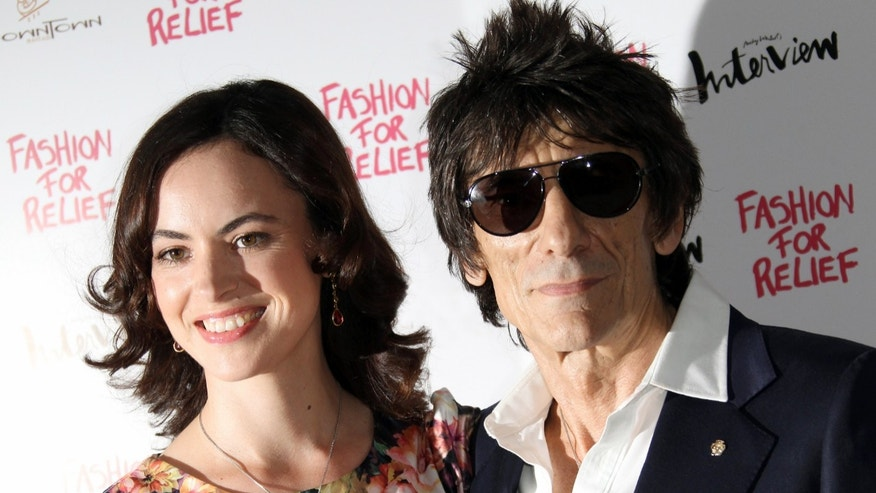 In this Thursday, Aug 9 2012 file photo, Ronnie Wood and Sally Humphreys arrive for a Fashion For Relief dinner in central London.