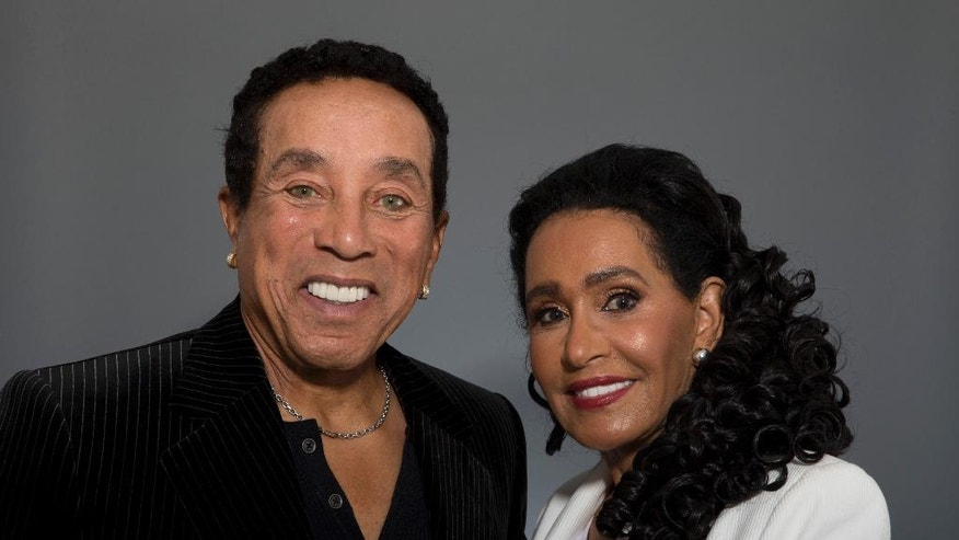 "In this May 27, 2016 photo, music legend Smokey Robinson and his wife, Frances Gladney, pose in Los Angeles to promote their new skincare lines, ""My Girl"" for women and ""Get Ready"" for men. (AP Photo/Jae C. Hong)"