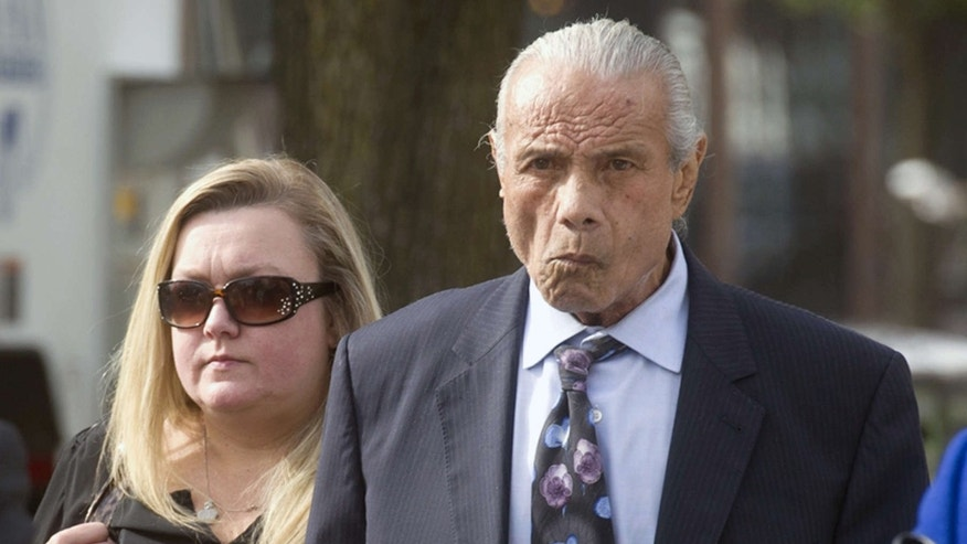 "FILE - In this Nov. 2, 2015, file photo, former professional wrestler Jimmy ""Superfly"" Snuka, right, arrives for his formal arraignment at the Lehigh County Courthouse in Allentown, Pa."