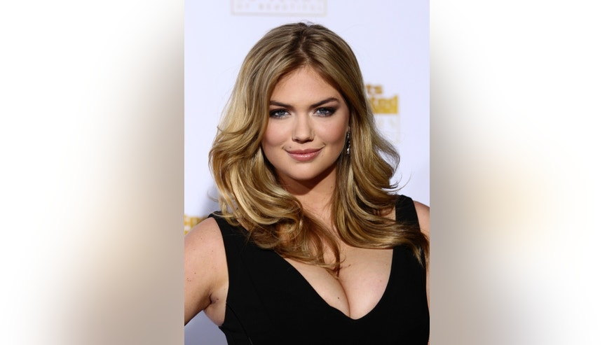 Kate Upton arrives for the 50 Years of Beautiful broadcast special show celebrating the 50th Anniversary of the Sports Illustrated Swimsuit Issue at the Dolby Theater in Los Angeles, California, January 14, 2014. REUTERS/David McNew (UNITED STATES - Tags: ANNIVERSARY ENTERTAINMENT HEADSHOT SPORT) - RTX17EOK