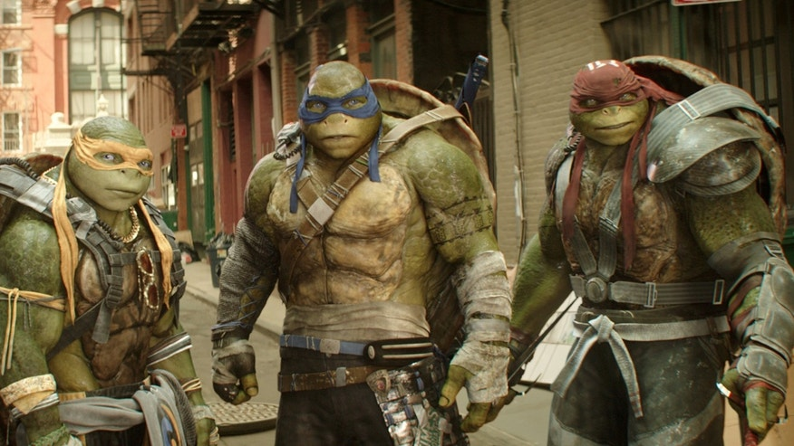 "This image released by Paramount Pictures shows, from left, Michelangelo, Leonardo and Raphael in a scene from ""Teenage Mutant Ninja Turtles: Out of the Shadows."""