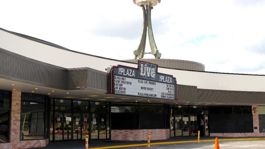 "The exterior of The Plaza Live theater, the location where singer Christina Grimmie was shot and killed the night before is shown as police hold a press conference discussing the death of the singer, Saturday, June 11, 2016, in Orlando, Fla. The gunman who shot and killed the singer who rose to fame after appearing on ""The Voice"" traveled to Orlando from another Florida city specifically to attack her and then fatally shot himself, authorities said Saturday.  (Jordan Krumbine/Orlando Sentinel via AP) MAGS OUT; NO SALES; MANDATORY CREDIT"