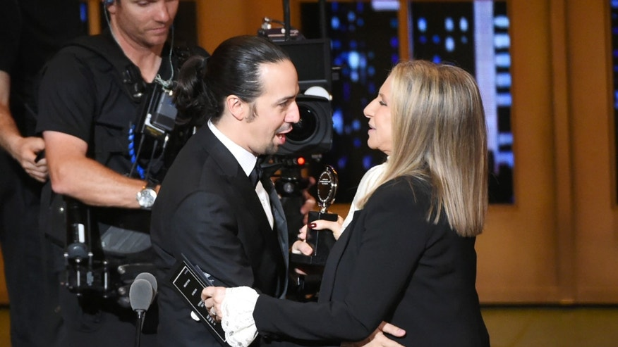 "Barbra Streisand, right,  presents the award for best musical to Lin-Manuel Miranda of ""Hamilton"" at the Tony Awards at the Beacon Theatre on Sunday, June 12, 2016, in New York. (Photo by Evan Agostini/Invision/AP)"