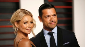 Actress Kelly Ripa and husband Mark Consuelos arrives at the Vanity Fair Oscar Party in Beverly Hills, California February 28, 2016.  REUTERS/Danny Moloshok - RTS8I83