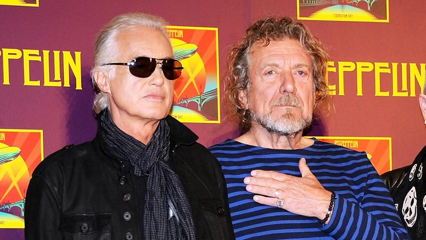 "FILE - In this Oct. 9, 2012 file photo, Led Zeppelin guitarist Jimmy Page, left, and singer Robert Plant appear at a press conference ahead of the worldwide theatrical release of ""Celebration Day,"" a concert film of their 2007 London O2 arena reunion show, in New York."