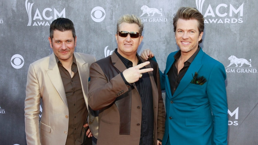 (L-R) Jay DeMarcus, Gary LeVox and Joe Don Rooney of the group Rascal Flatts arrive at the 49th Annual Academy of Country Music Awards in Las Vegas, Nevada April 6, 2014.  REUTERS/Steve Marcus  (UNITED STATES - Tags: ENTERTAINMENT)(ACMAWARDS-ARRIVALS) - RTR3K6SR