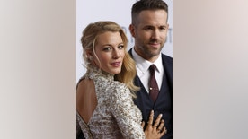 Blake Lively (L) and Ryan Reynolds attend the 2016 amfAR New York Gala at Cipriani Wall Street in Manhattan, New York February 10, 2016. REUTERS/Andrew Kelly  - RTX26F50