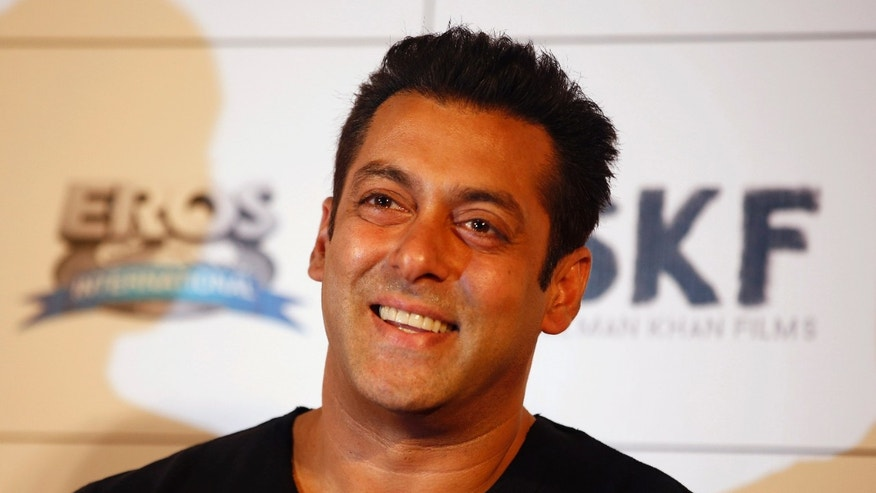 "FILE- In this June 18, 2015 file photo, Bollywood actor Salman Khan smiles during the trailer launch of his upcoming movie ""Bajrangi Bhaijaan"" in Mumbai, India. Khan has caused a public uproar by telling reporters that shooting his new film ""Sultan"" was so grueling that he felt like a raped woman.(AP Photo/Rajanish Kakade, File)"