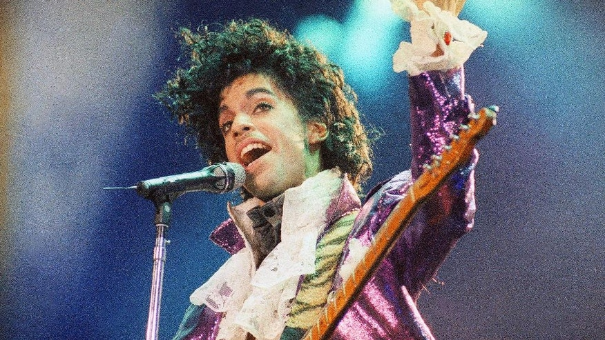 "FILE - In this Feb. 18, 1985 file photo, Prince performs at the Forum in Inglewood, California. Singer Judith Hill says she was on a plane with Prince when it made an emergency landing in Illinois after he lost consciousness less than a week before his death. Hill told The New York Times that she was ""very freaked out"" when Prince lost consciousness in the middle of a conversation. Prince died of an accidental overdose of the painkiller fentanyl six days later. (AP Photo/Liu Heung Shing, File)"