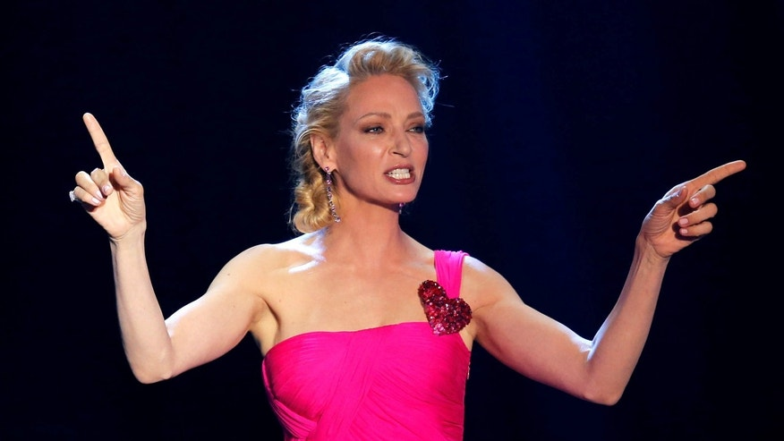 May 19, 2016: Actress Uma Thurman conducts an auction during the amfAR's Cinema Against AIDS 2016 event during the 69th Cannes Film Festival in Antibes, near Cannes, France.