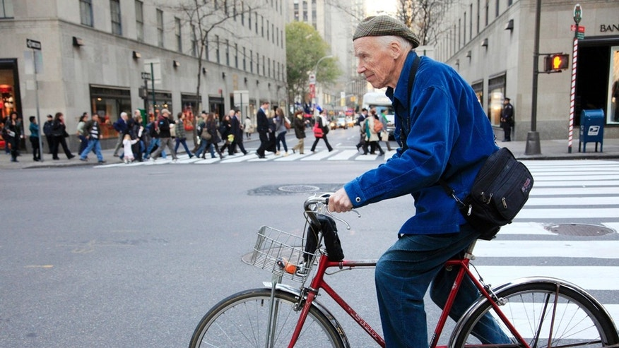 Nov. 23, 2010: New York Times photographer Bill Cunningham bicycles to work in New York. Cunningham, 87, died Saturday after suffering a stroke