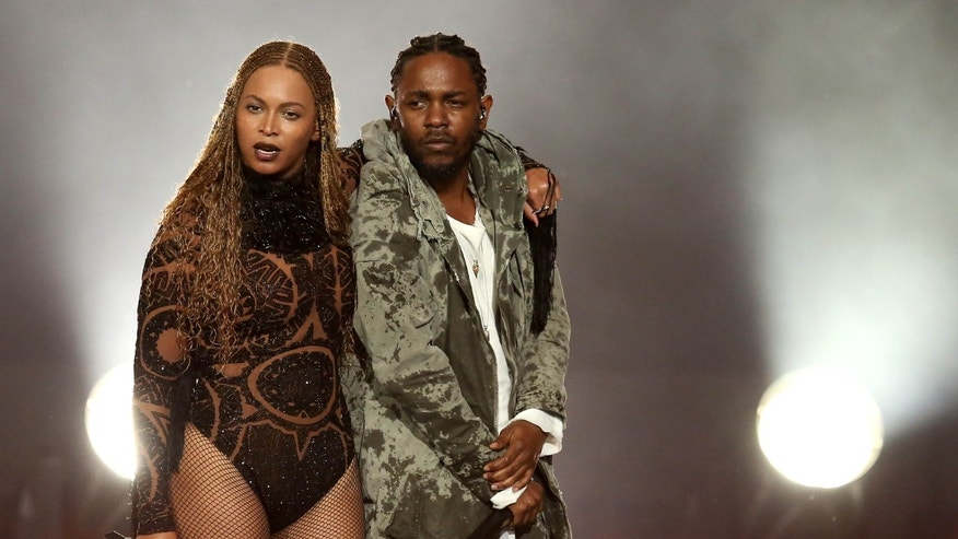 """Beyonce, left, and Kendrick Lamar perform """"Freedom"""" at the BET Awards at the Microsoft Theater on Sunday, June 26, 2016, in Los Angeles."""