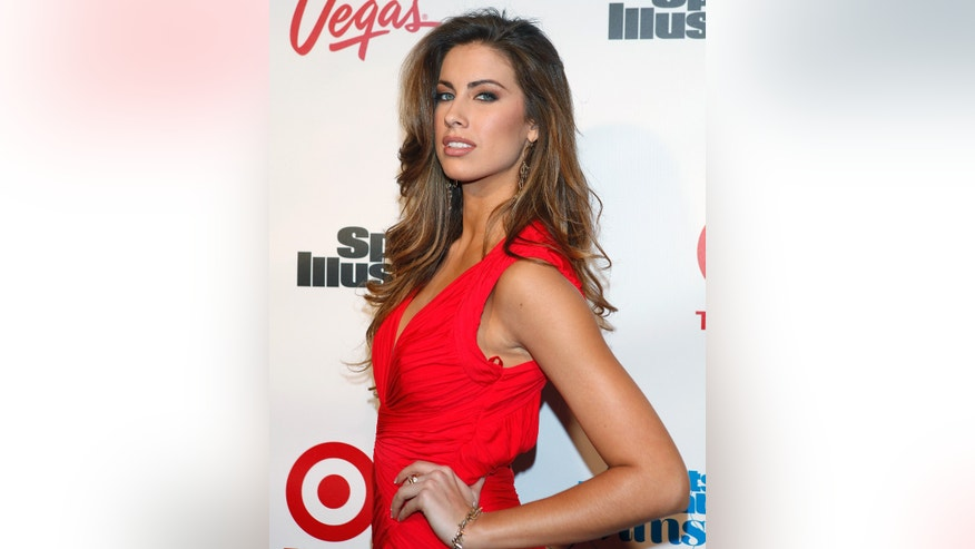 Model Katherine Webb arrives for Sports Illustrated's Swimsuit issue launch party in New York, February 12, 2013.  REUTERS/Carlo Allegri  (UNITED STATES) - RTR3DPX0