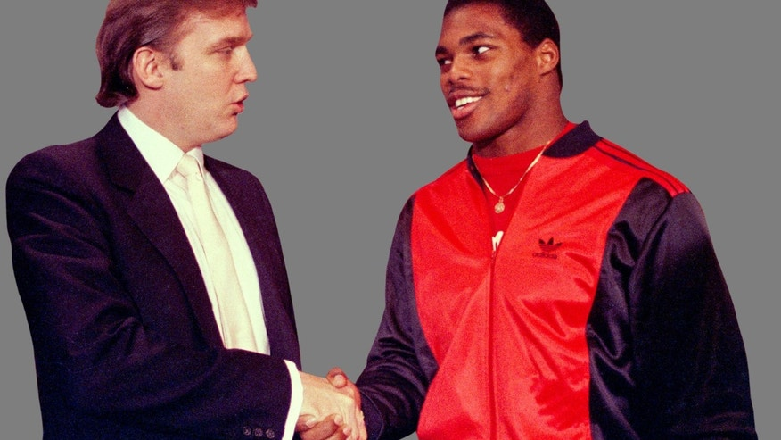 Donald Trump shakes hands with Herschel Walker, after agreement on a -4year contract with the New Jersey Generals USFL football team in 1984.