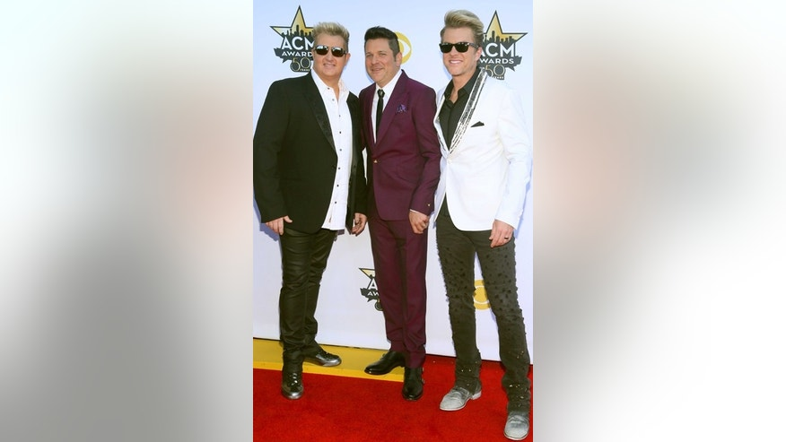 Gary LeVox, from left, Jay DeMarcus and Joe Don Rooney, of Rascal Flatts, arrive at the 50th annual Academy of Country Music Awards at AT&T Stadium on Sunday, April 19, 2015, in Arlington, Texas. (Photo by Jack Plunkett/Invision/AP)