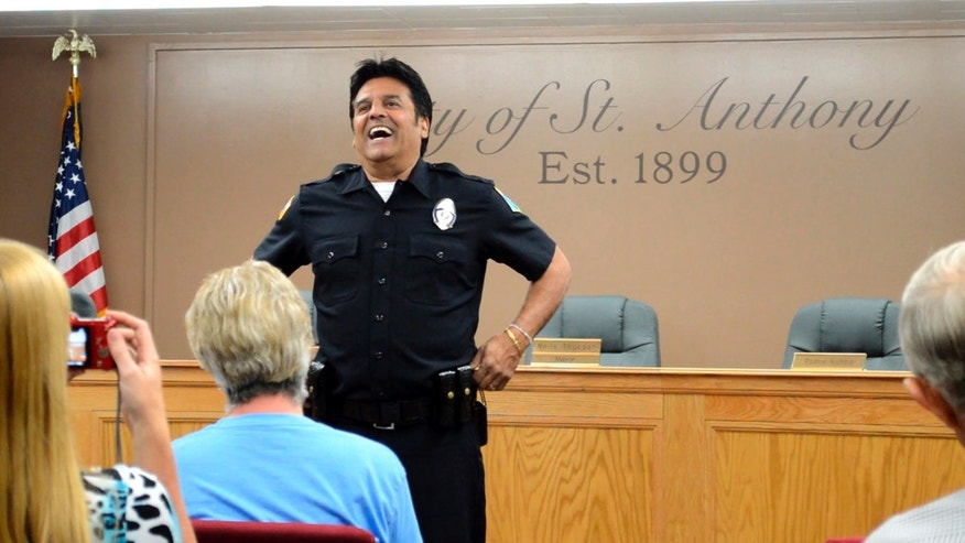 "In this Saturday, July 2, 2016, photo famed ""CHiPs"" police officer Erik Estrada mets St. Anthony residents to discuss his efforts with the St. Anthony Police Department to stop internet enticement of children at St. Anthony City Hall. Estrada has spent the past decade working with various law enforcement departments to keep kids safe online. Following his induction Estrada as a now a St. Anthony Police Department reserve officer, he told how important it is to teach children what not to do while on the web. (Lisa Dayley-Smith/Rexburg Standard Journal via AP) MANDATORY CREDIT"